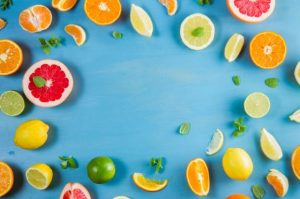 different sliced fruits with blue background