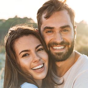 Headshot of a couple smiling
