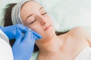 woman receiving dermal fillers