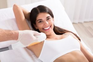 female patient undergoing laser hair removal